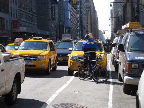 NYPDBikeCopTicketingTaxi-viaStreetsblog.jpg