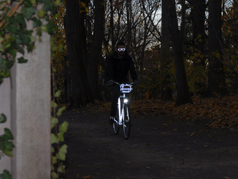 JoshuaZisson-RetroreflectiveBike-ConstanceWinters-ridingfront.jpg