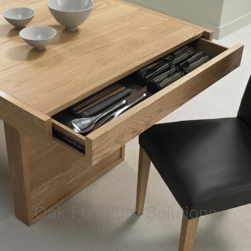 An uncommon storage space the dining table core77 for Dining room tables with storage