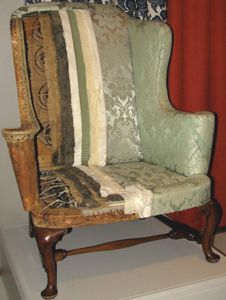 furniture design history why do wingback chairs have wings