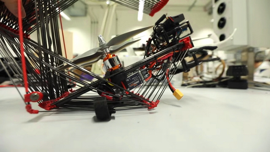 This Origami-Inspired, Shrinkable Cargo Drone Flies Within a Foldable Protective Sphere