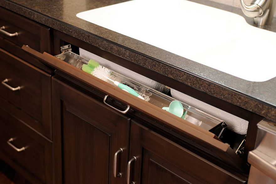 space efficient storage tip out designs core77 rh core77 com  under kitchen sink pull out storage