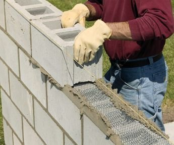 An Easy Way to Build Retaining Walls: Leave the Concrete in the Bag, Stack Like Legos, Wet With a Hose