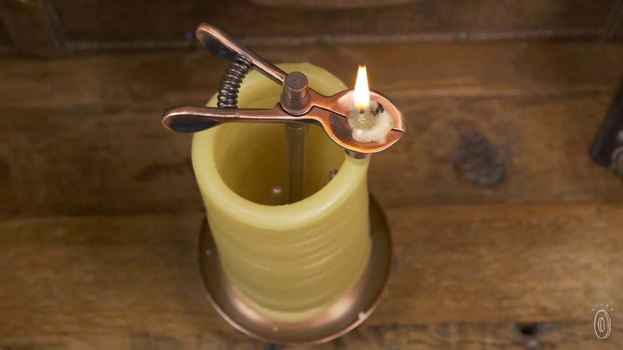 Primitive Timing/Lighting Device: A Self-Extinguishing Coiled Candle