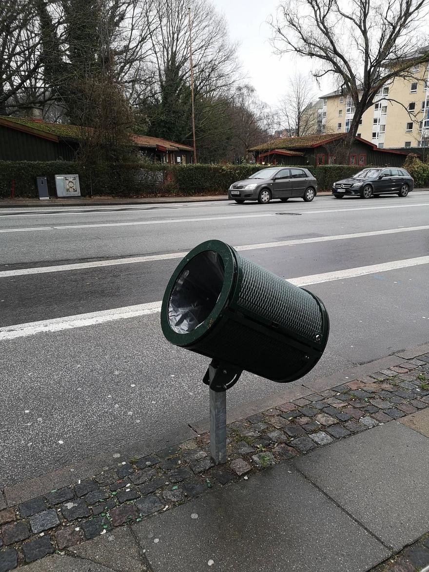 What is Your Design Advice for These Tilted Trashcans Next to Bike Paths?