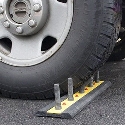 """Passive-Aggressive Product Design: """"U-Turn Deterrent"""" Fake Tire Spike Strips for Your Driveway"""