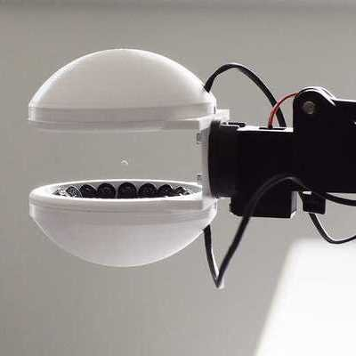 A Robot Hand That Uses Acoustic Levitation to Move Objects Without Touching Them