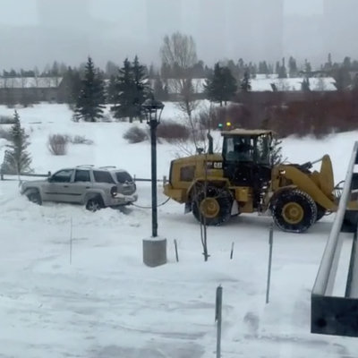 Stuck Driver Being Towed Out of a Snowdrift Doesn't Pay Attention, Badly Damages Car - Core77