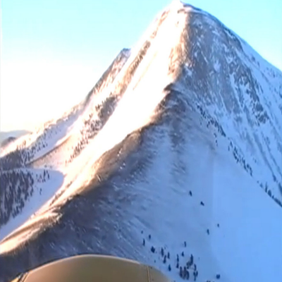 Next Best Thing to a Helicopter: Watch as This Guy Lands a Plane on the Side of a Mountain!