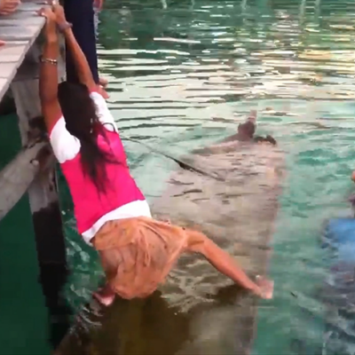 Young Girl Uses a Clever Method of Quickly Bailing Out a Sinking Canoe With Her Legs