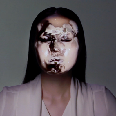 """Technology Art:"" Combining Facial Tracking and Projection Mapping for Real-Time Face Hacking"